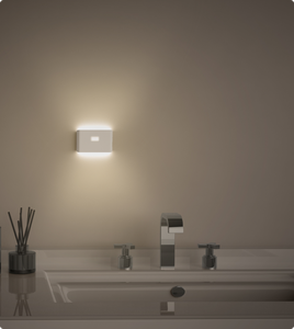 Bathroom vanity lit up by Wyze night light applied to wall