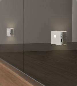Hallway lit up by Wyze night light applied to mirror closet