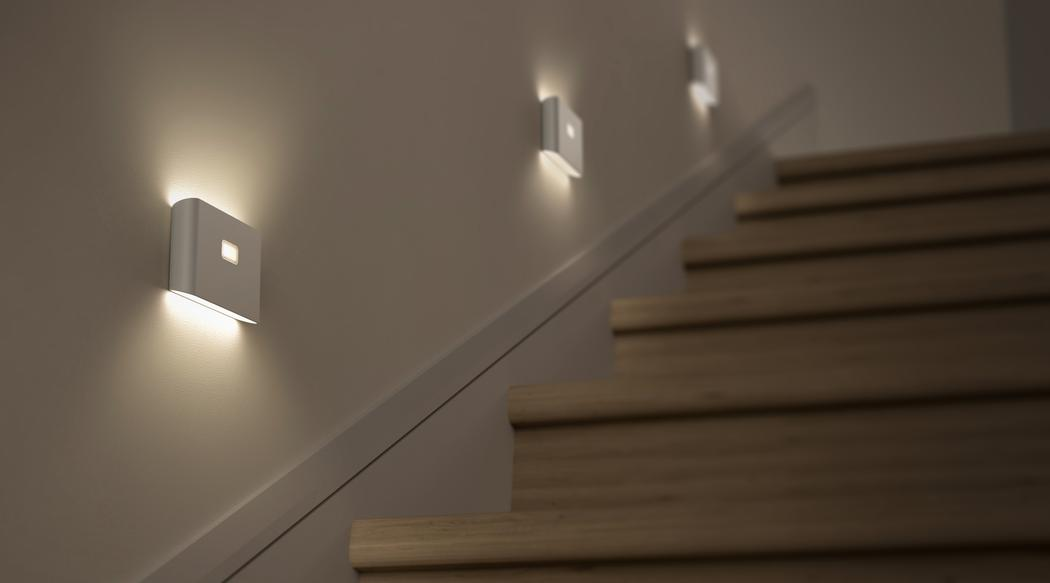 Home stairwell lit up by Wyze night lights along wall