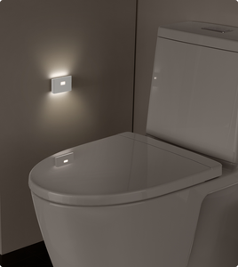 Bathroom toilet area lit up by Wyze night light applied to wall