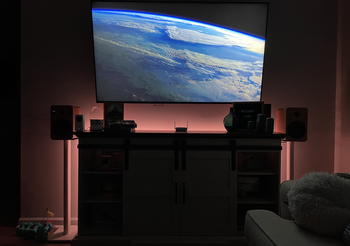 Wall tv illuminated by warm colors from Wyze Lightstrip