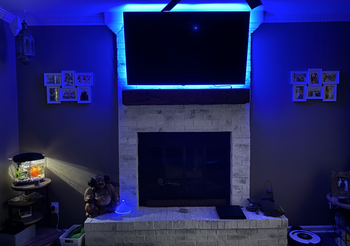 Fireplace and mantle lit up with blue light from Wyze Lightstrip