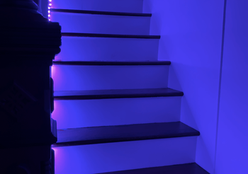 Stairwell lit up with blue light from Wyze Lightstrip