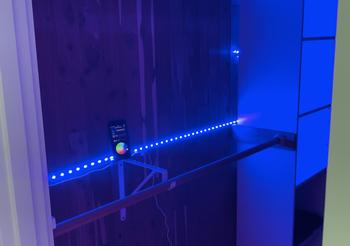 Blue Wyze Lightstrip lined along the inside of a bedroom closet