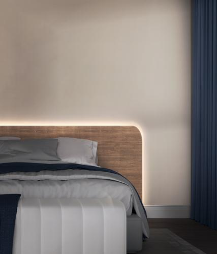 Bedroom dimly lit by Wyze Lightstrip from setting sleep routines in Wyze app
